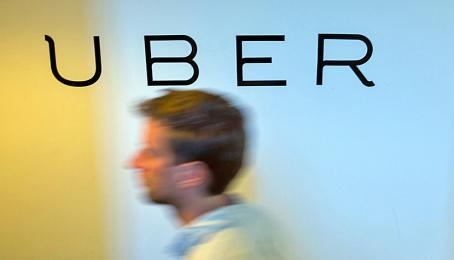 A logo sits on the wall inside the offices of Uber Technologies Inc. at Factory Berlin tech hub in Berlin, Germany, on Monday, May 9th, 2016.
