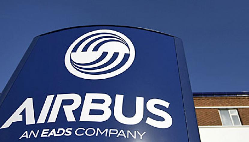 A logo sits on a sign outside the Airbus wing assembly factory in Broughton, U.K., on Monday, Feb. 4, 2013.