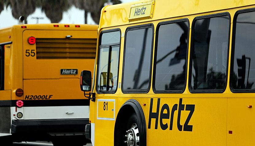 Hertz Global Holdings Inc. shuttle buses transport passengers to the rental location at Los Angeles International Airport (LAX) in Los Angeles, California, U.S., on Friday, July 26, 2013.