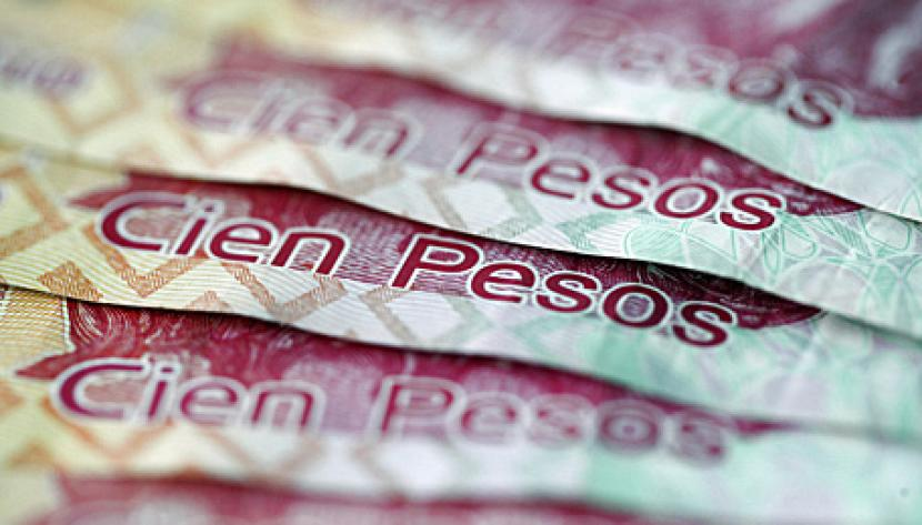 Mexican one hundred pesos notes are arranged for a photograph in London, U.K., on Wednesday, Feb. 23, 2011.