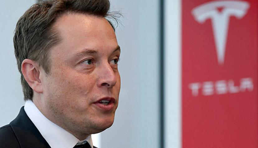 Elon Musk, co-founder and chief executive officer of Tesla Motors Inc., speaks during a news conference in Tokyo, Japan, on Monday, Sept. 8, 2014.