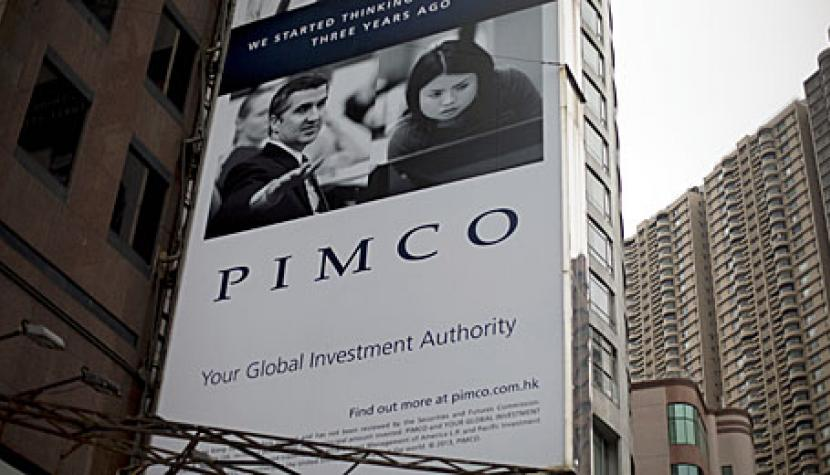 A Pacific Investment Management Company LLC (PIMCO) advertisement is displayed on a building in Hong Kong, China, on Wednesday, Nov. 13, 2013.